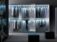 Wardrobe with L12 sliding doors in clear grigio glass with matt metallic grigio grafite lacquered frames. Top panels and shelves are fitted with full-length led light strips and a motion sensor.