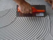 Cement adhesive for flooring DRYKOLL - CVR