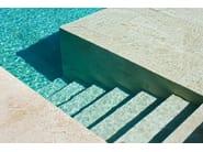 In-Ground travertine swimming pool Travertine swimming pool - INDALO PISCINE