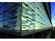 Stretched mesh for facade finish STAMISOL® COLOR - Stamisol by Serge Ferrari