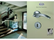 Brass door handle on rose MANOS | Door handle - KLEIS