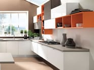 Wooden fitted kitchen without handles