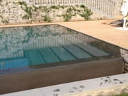 Infinity swimming pool with waterfall Infinity swimming pool - INDALO PISCINE