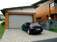 Side sectional garage door PHENIX - Breda Sistemi Industriali