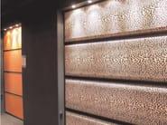 Sectional sandstone garage door TEXTILES JEWELS - Breda Sistemi Industriali