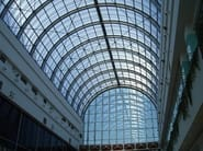 Curved polycarbonate roofing. City mall. Bucharest