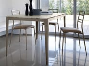Extending lacquered rectangular laminate table