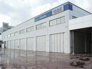 Industrial folding door / Sliding industrial door Portoni a libro - Kopron