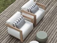 Upholstered garden armchair with armrests CLAUD | Armchair - Meridiani