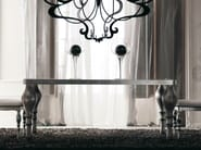 "Top: fitted glass black colour with iron frame ""melange"" silver leaf finish. Legs: sandblasted wood ""marquinia"" silver leaf"