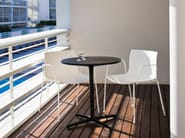 Round table with 4-star base GINGER H 74   Round table - Arper