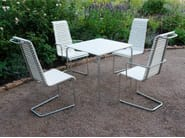 Cantilever steel and wood garden chair with armrests DJURGÅRDSBRUNN | Garden chair - Nola Industrier