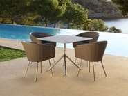 Synthetic fibre garden chair with armrests SHELL CHAIR | Garden chair - FueraDentro