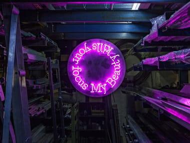 Wall-mounted neon light installation BEAUTY
