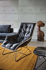 Sled base upholstered leather armchair with removable cover