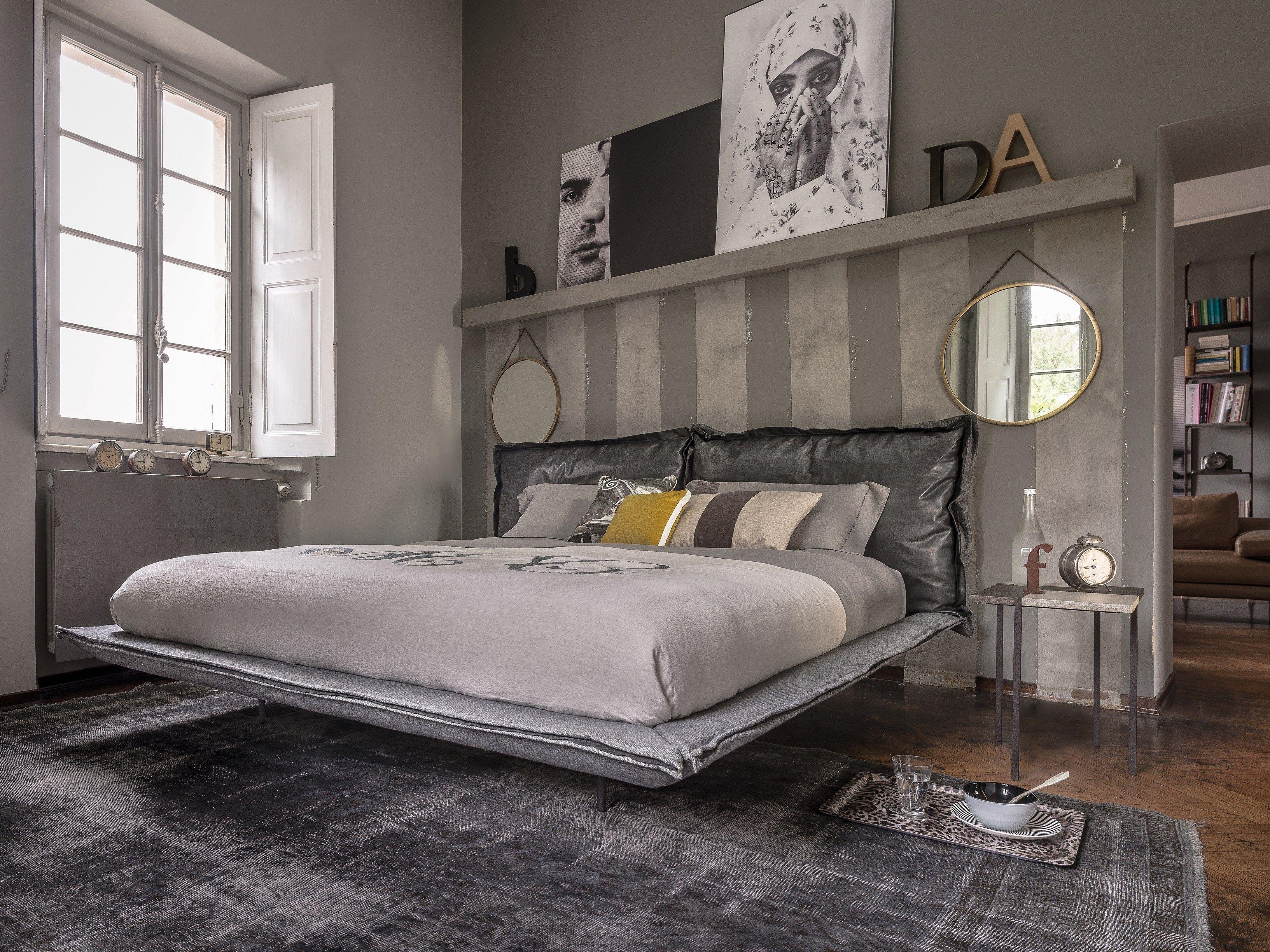 Double bed with upholstered headboard auto reverse dream for Camera da letto uomo