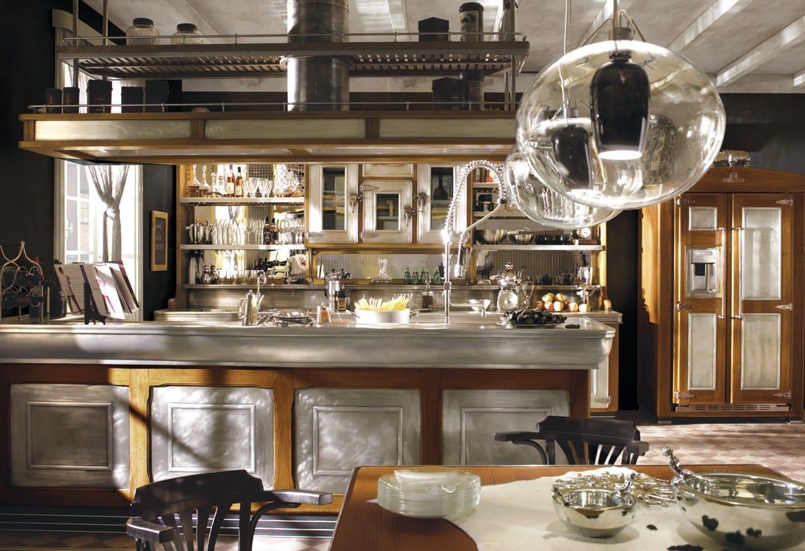 Cucina componibile in acciaio inox e legno con isola bar - Cucine marchi prezzi ...