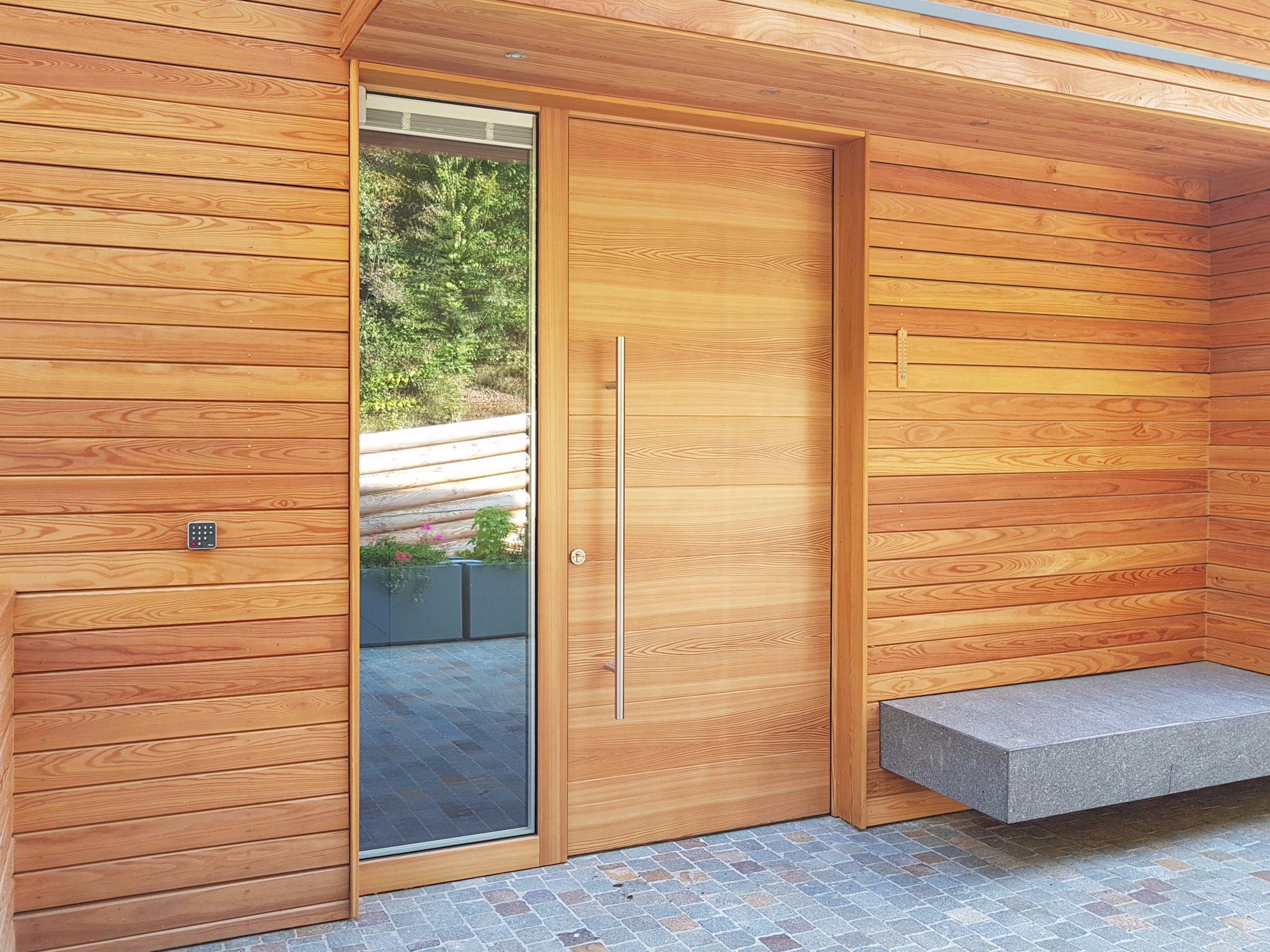 Porta d 39 ingresso in legno su misura clima 72 by alpilegno - Portoni in legno prezzi ...