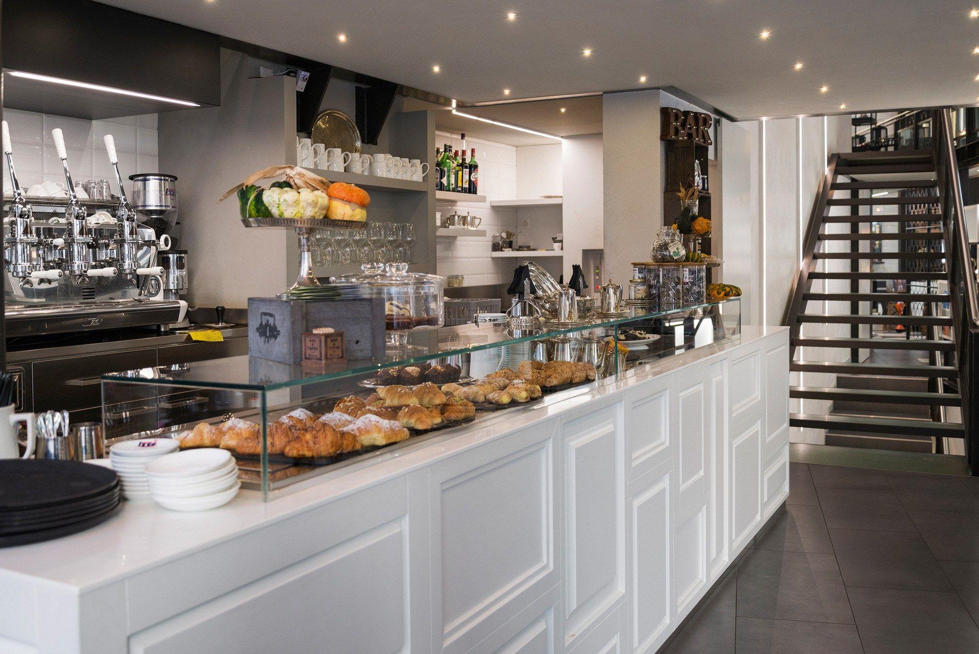 Arredo per negozi by tm italia cucine for Store arredo