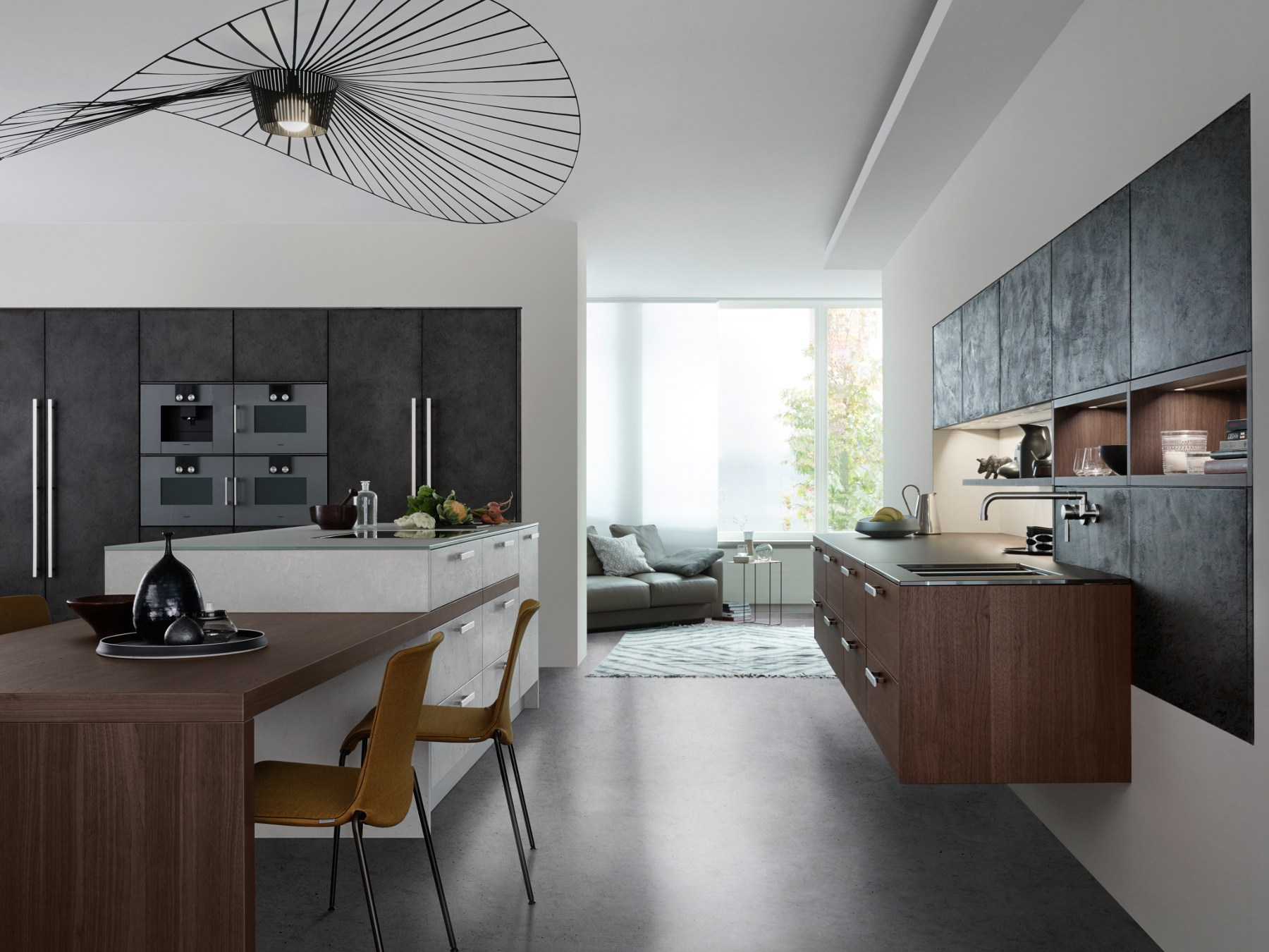 Kitchen with island topos concrete by leicht k chen for Ilot central avec table retractable