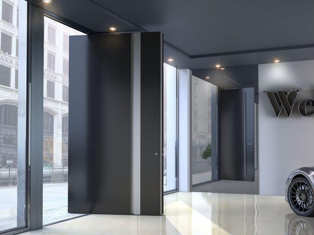 Porta d 39 ingresso rototraslante in alluminio zen pivot carbon by interno doors for Porte zen fiber