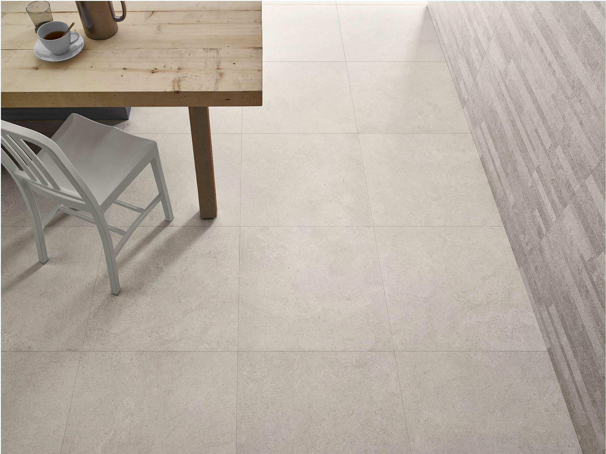 Porcelain stoneware flooring with stone effect nest for Carrelage stone