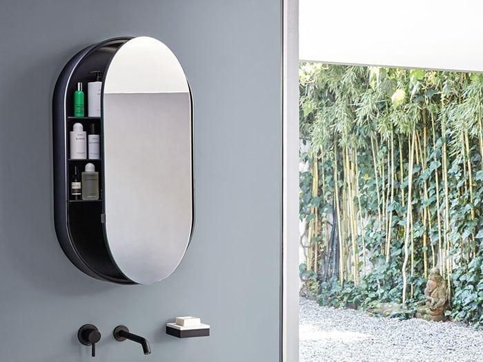 Specchio ovale a parete con contenitore i catini oval box for Casa miroir rond