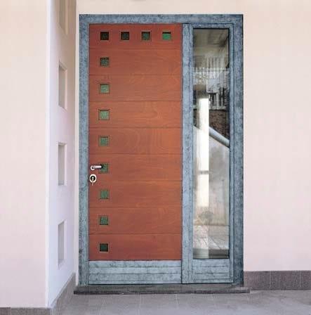 Porta d 39 ingresso con pannelli in vetro by carminati serramenti for Porta ingresso vetro