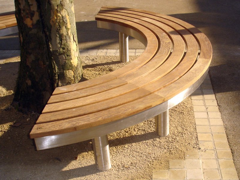 curved stainless steel and wood bench tree access tree