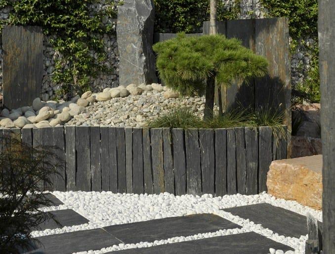 Cl ture en pierre naturelle by granulati zandobbio for Cloture naturelle