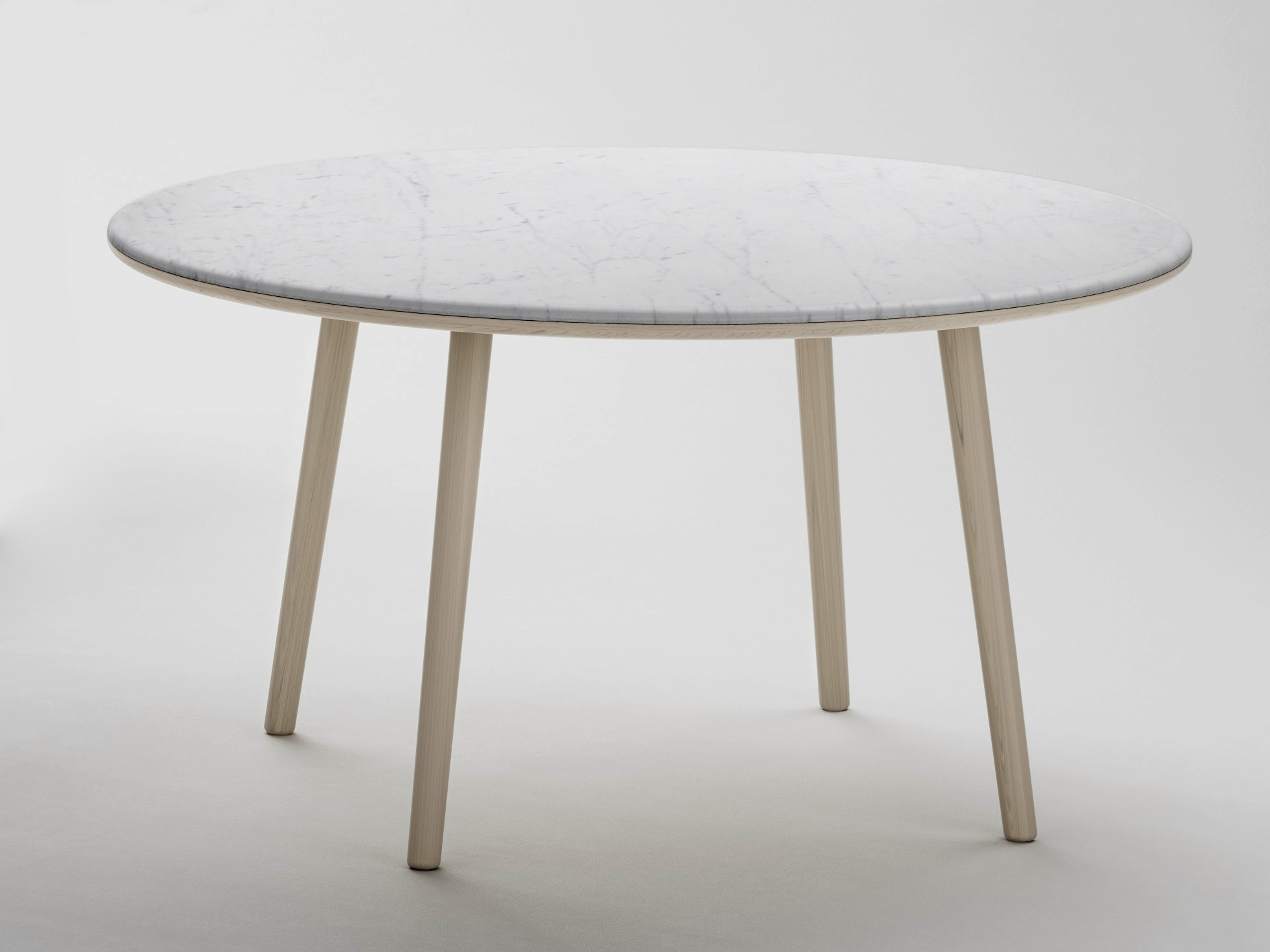 Arin table ronde by retegui design jean louis iratzoki - Table marbre ronde ...