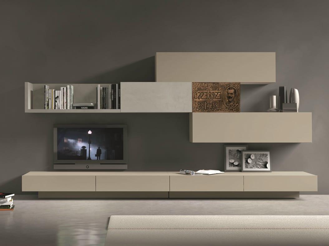 Parete attrezzata componibile fissata a muro con porta tv for Mobili design