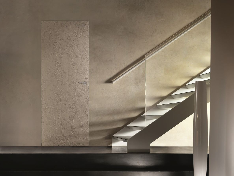 Porta a filo muro scorrevole con finitura effetto cemento baklite by barausse - Porta a filo muro prezzi ...