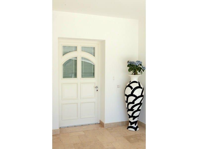 Puerta de entrada acristalada by de carlo casa for Puerta acristalada exterior