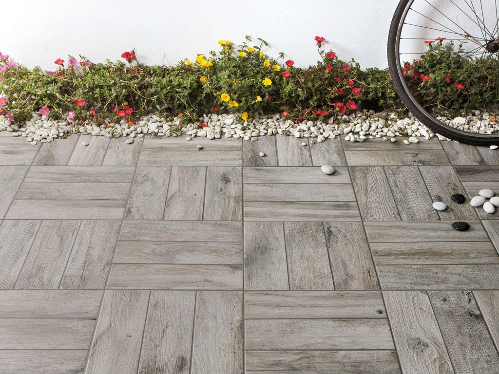 Outdoor floor tiles with wood effect decking by ceramica for Garden decking squares