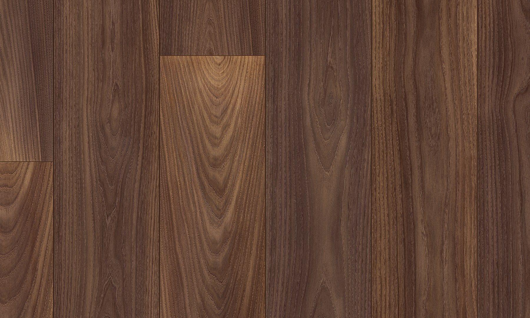 Pavimento en laminado imitaci n madera nogal alpine by pergo for Suelos laminados adhesivos