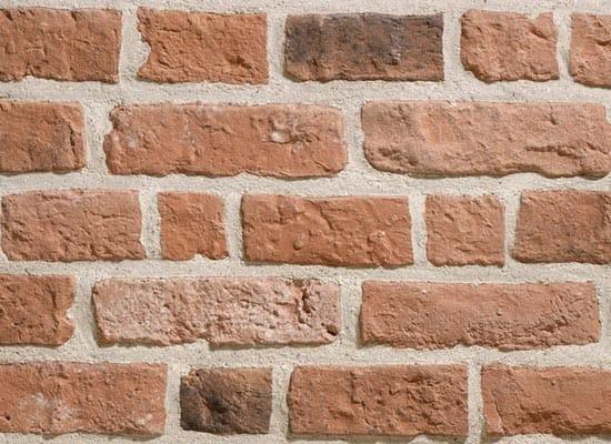 Rivestimento in pietra ricostruita effetto mattone for Piastrelle effetto mattone