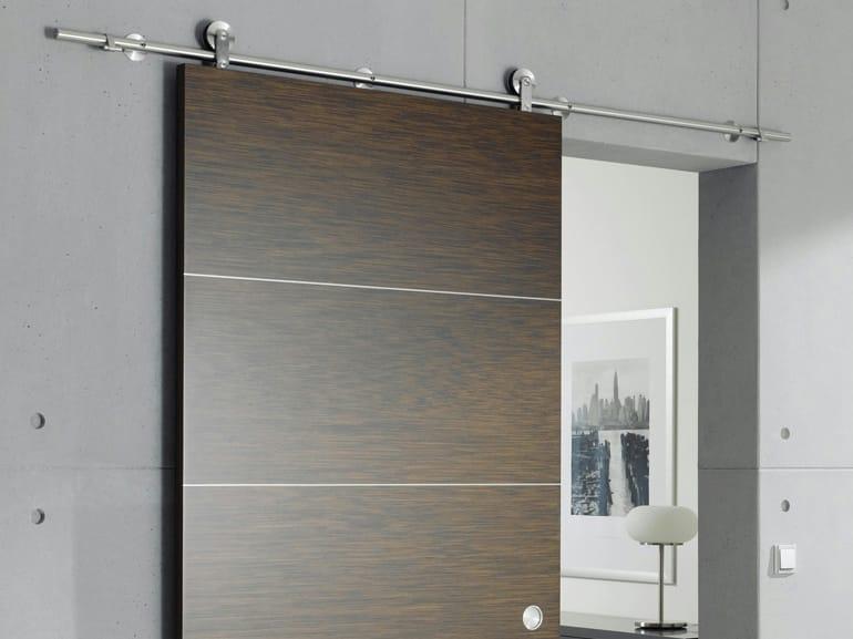 Puerta corrediza de madera sin marco supra by wolfsgruber for Puertas de exterior con cristal