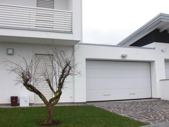 Il portone sezionale Persus di Breda per un complesso residenziale di Curtatone