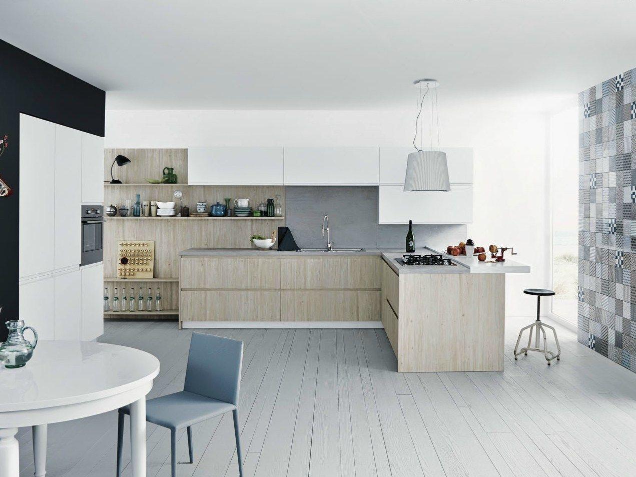 Mila: cemento e legno di larice per lambiente cucina