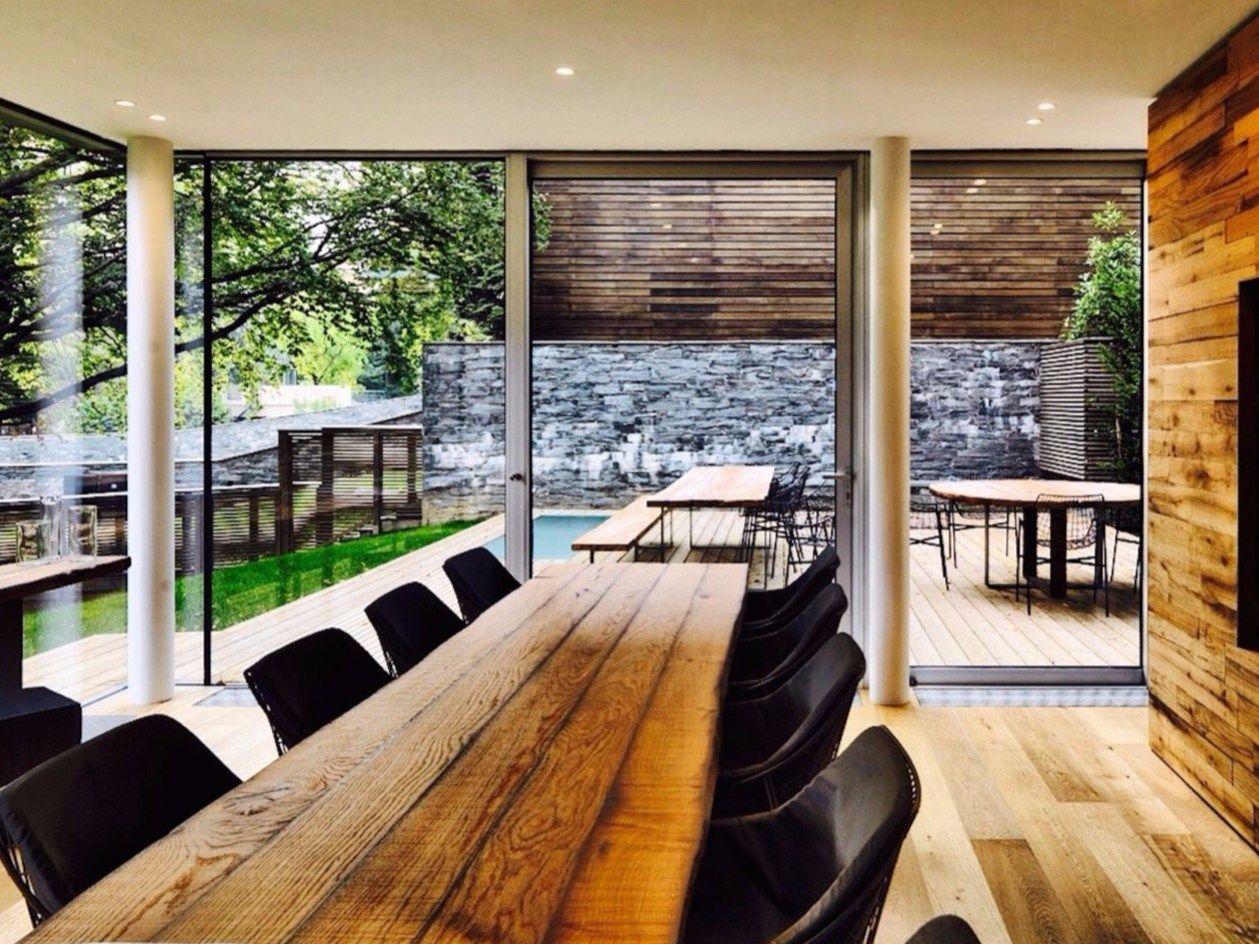 Una casa nascosta tra alberi secolari sul Lago di Como