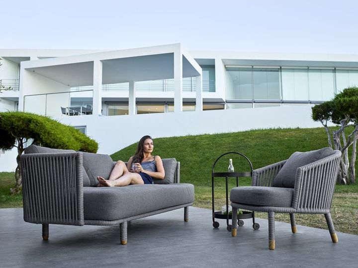 Cane Line Garden Furniture Cane line bridges the gap between indoor and outdoor cane line moment sofa and loungechair roll sidetable workwithnaturefo