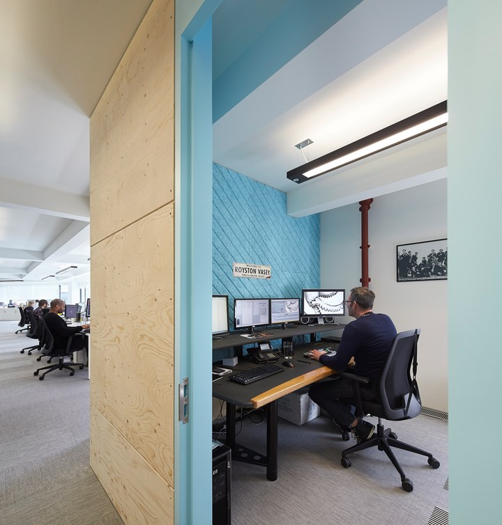 A Former Carpet Factory Becomes a Colorful Workspace