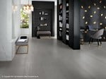 Porcelain stoneware flooring with concrete and metal effect