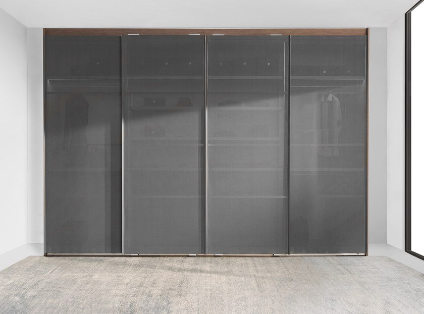 Wardrobe with canvas sliding doors AIR by Ornare