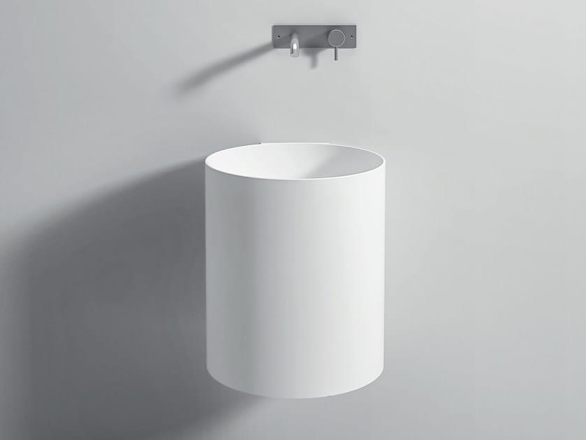 Wall-mounted Corian® washbasin UNICO | Round washbasin by Rexa Design