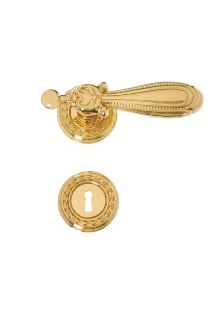 Brass door handle on rose 724 - CARLOTTA | Door handle by Enrico Cassina