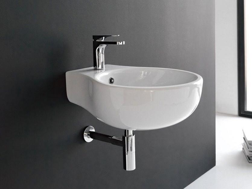 Round wall-mounted ceramic washbasin ABC | Wall-mounted washbasin by Hidra Ceramica