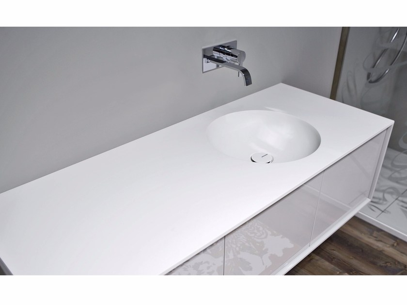 Corian® washbasin with integrated countertop BACINO by Antonio Lupi Design