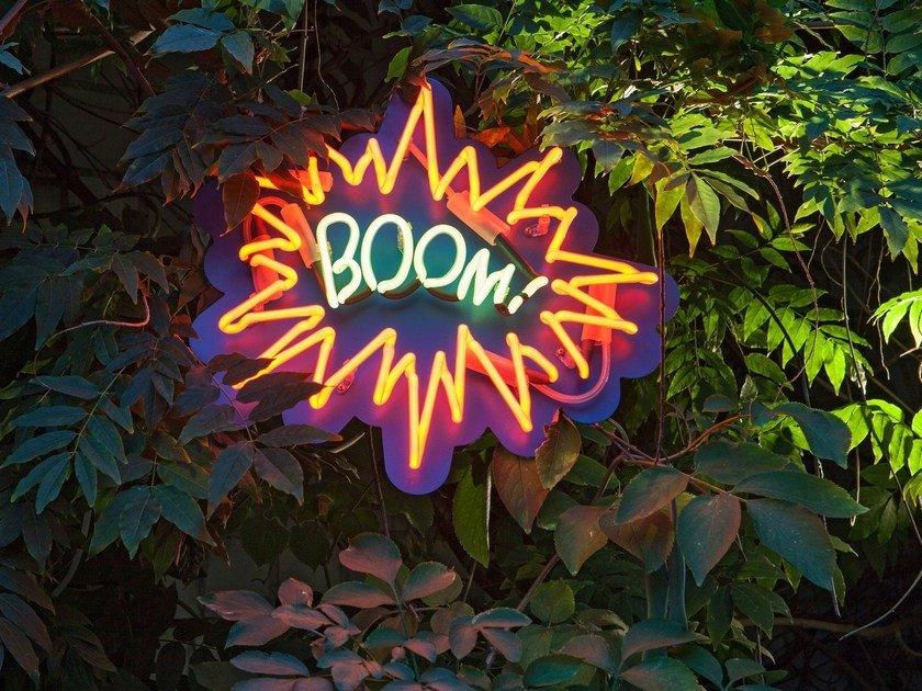 Wall-mounted neon light installation BOOM by sygns